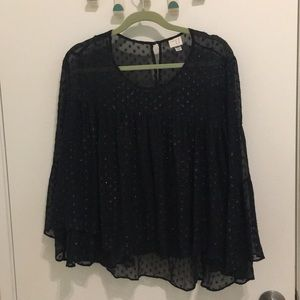 Black shimmery flowly top.